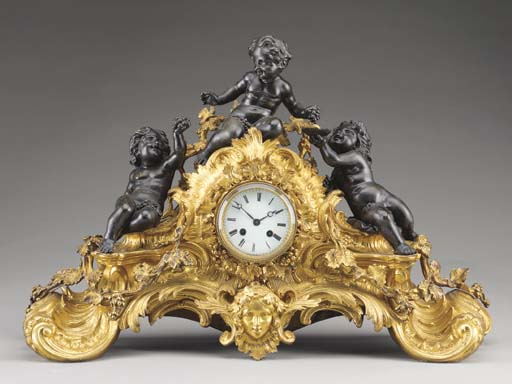 A Louis XV style ormolu and patinated bronze mantel clock,