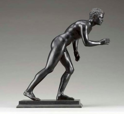 A PATINATED BRONZE STATUE OF A