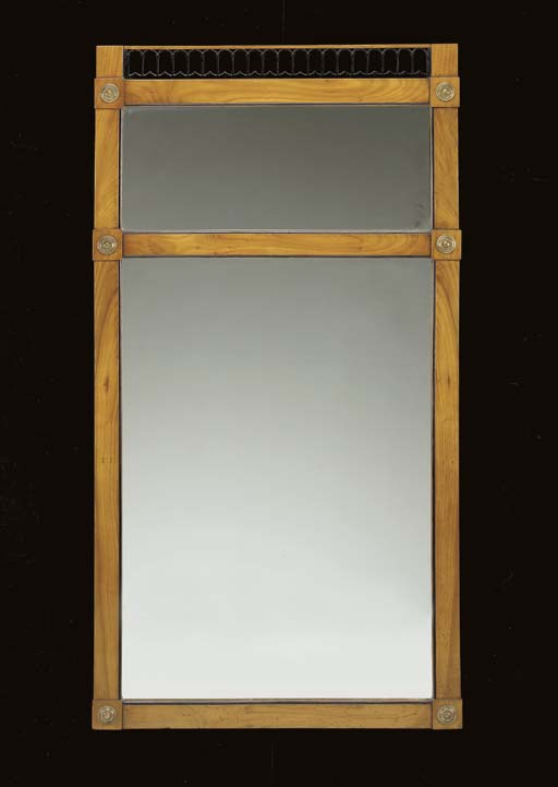 A BIEDERMEIER EBONIZED AND CHERRY BRASS-MOUNTED MIRROR,