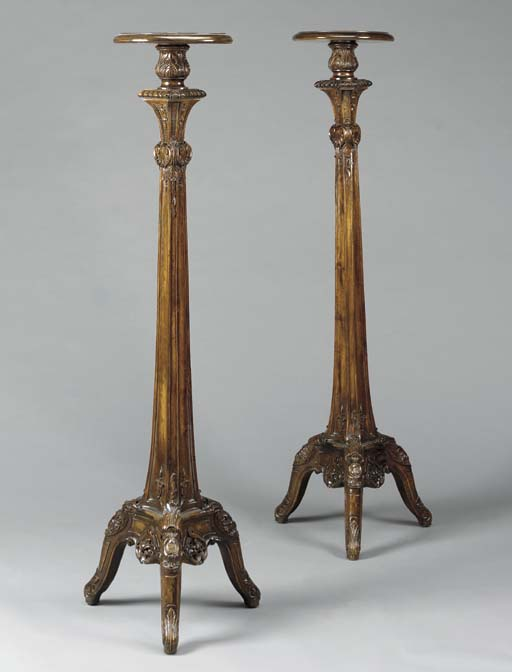 A PAIR OF GEORGE II STYLE STAINED MAHOGANY TORCHERES,