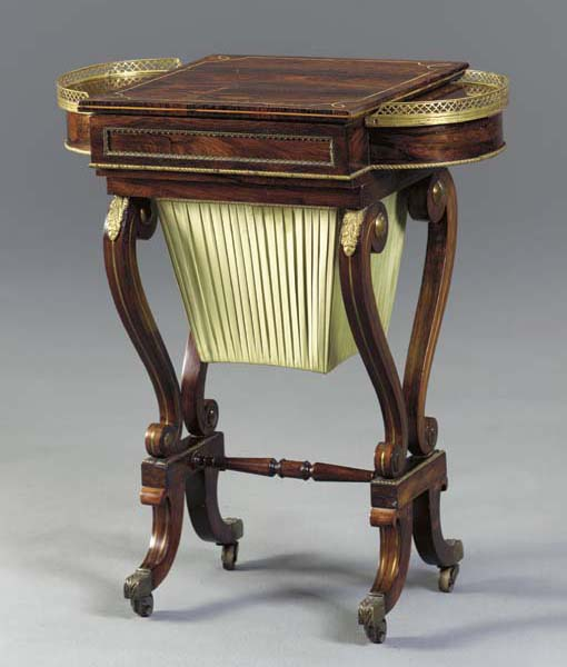A REGENCY BRASS-INLAID AND MOUNTED ROSEWOOD GAMES TABLE,