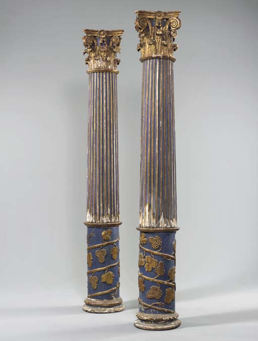 A PAIR OF ITALIAN BLUE-PAINTED AND PARCEL-GILT COLUMNS,