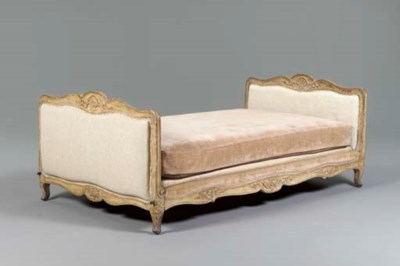 A LOUIS XV CREAM-PAINTED BED,