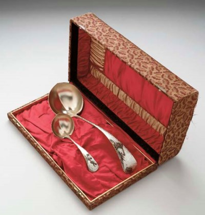 A SET OF TWO SILVER AND MIXED-