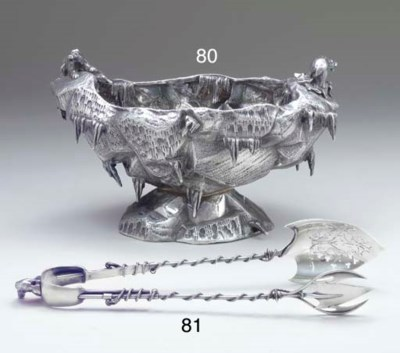 A PAIR OF SILVER ICE TONGS