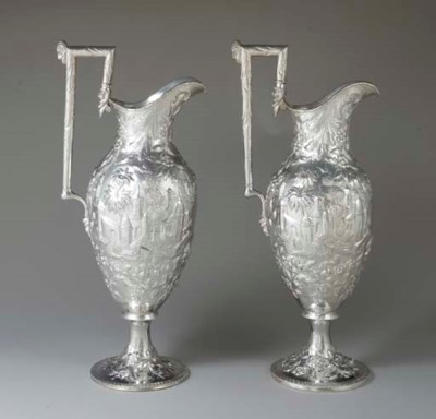 A PAIR OF SILVER EWERS