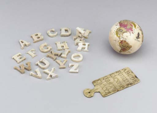 A SCRIMSHAW WHALEBONE TABLET CARVED WITH THE ALPHABET