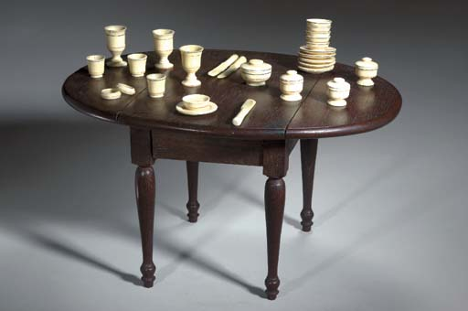 A SCRIMSHAW MINIATURE TEA SET ON A MINIATURE MAHOGANY DROP-LEAF TABLE