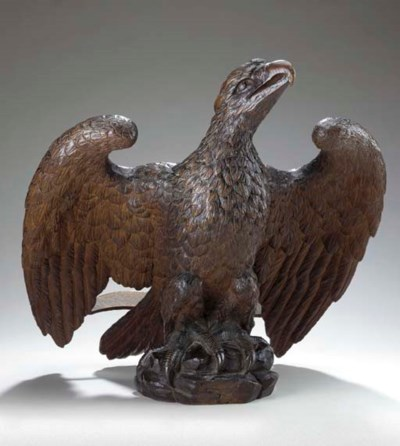 A CARVED OAK EAGLE LECTERN