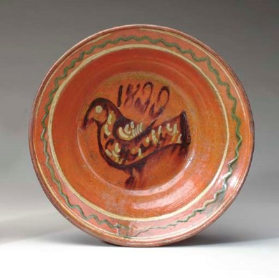 A GLAZED REDWARE CHARGER