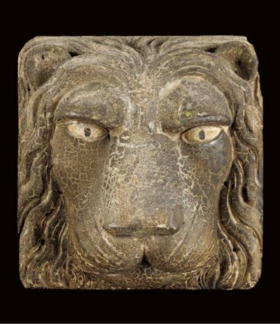 A CARVED AND PAINTED LION'S-HE