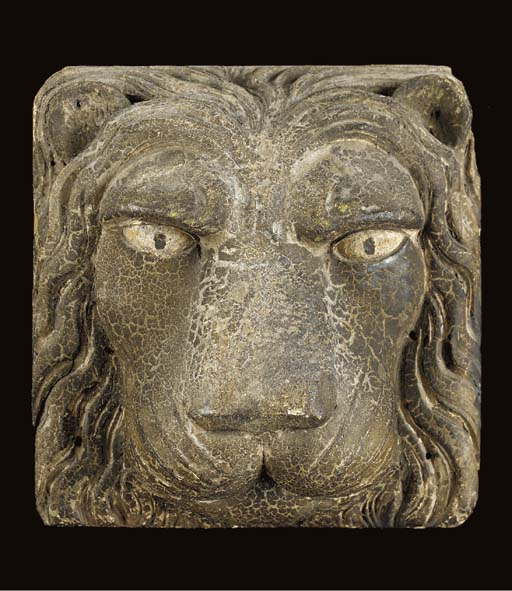 A CARVED AND PAINTED LION'S-HEAD ARCHITECTURAL ORNAMENT