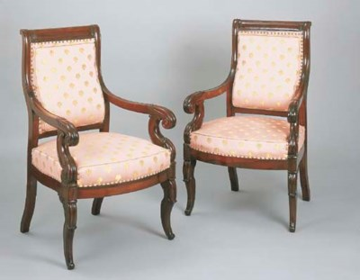 A PAIR OF CARVED MAHOGANY ARMC
