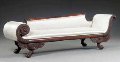 A CLASSICAL CARVED MAHOGANY RE