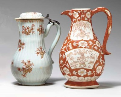 TWO IRON-RED AND GILT JUGS