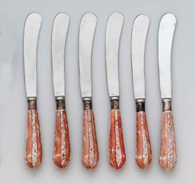 A RARE SET OF SIX IRON-RED AND