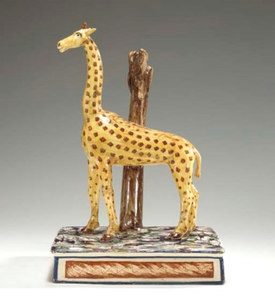 A CREAMWARE MODEL OF A GIRAFFE