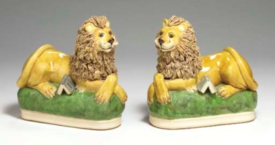 A PAIR OF STAFFORDSHIRE RECUMB