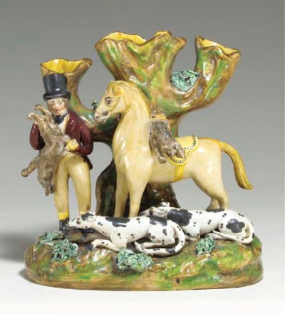 A STAFFORDSHIRE PEARLWARE COUR