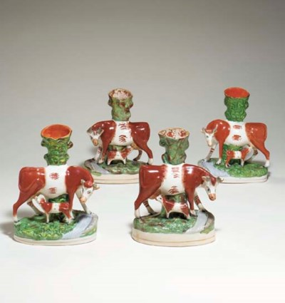 TWO PAIRS OF STAFFORDSHIRE COW