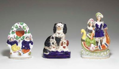 A STAFFORDSHIRE WATCH STAND AN