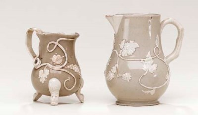 TWO STAFFORDSHIRE DRABWARE CRE