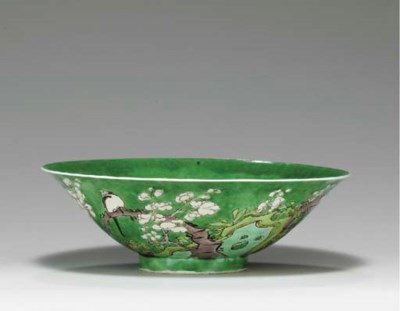 A GREEN GROUND CONICAL BOWL