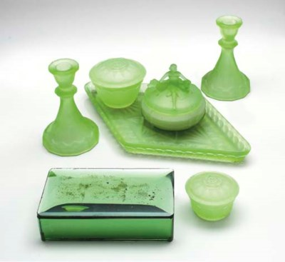 A GROUP OF GREEN GLASS TABLE A