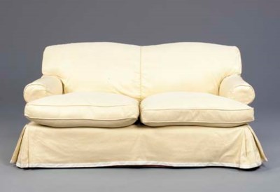 A YELLOW UPHOLSTERED SOFA BY G