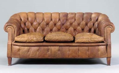 A BROWN TUFTED LEATHER UPHOLST