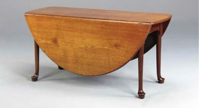 A GEORGE II MAHOGANY DROP LEAF