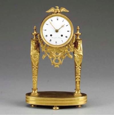 AN EMPIRE ORMOLU MANTLE CLOCK,