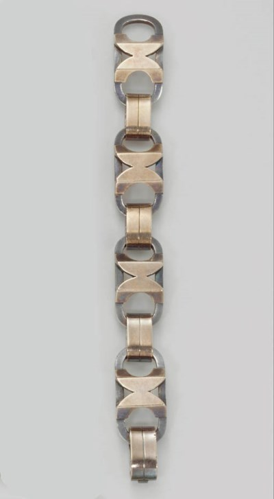 A SILVER AND COPPER BRACELET