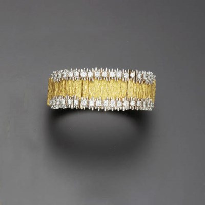 A GOLD AND DIAMOND BRACELET WA