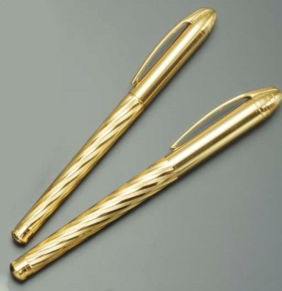 A PAIR OF GOLD-PLATED PENS, BY