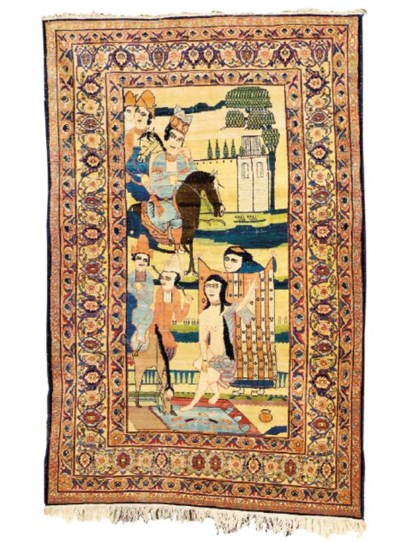 A PICTORIAL KIRMAN RUG,