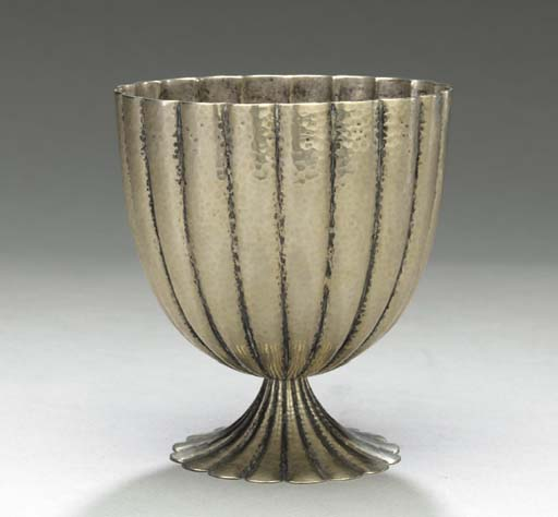 A HAMMERED SILVERED METAL COUP