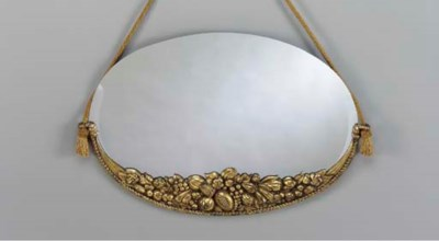 A GILT BRONZE MIRROR