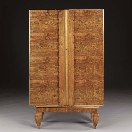 A BRASS INLAID WALNUT ARMOIRE