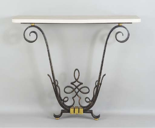 A WROUGHT IRON AND PARCEL GILT