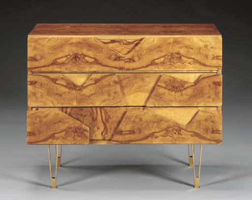 A WALNUT AND BRASS CHEST OF DR