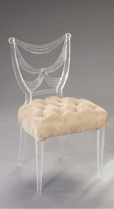 A LUCITE SIDE CHAIR