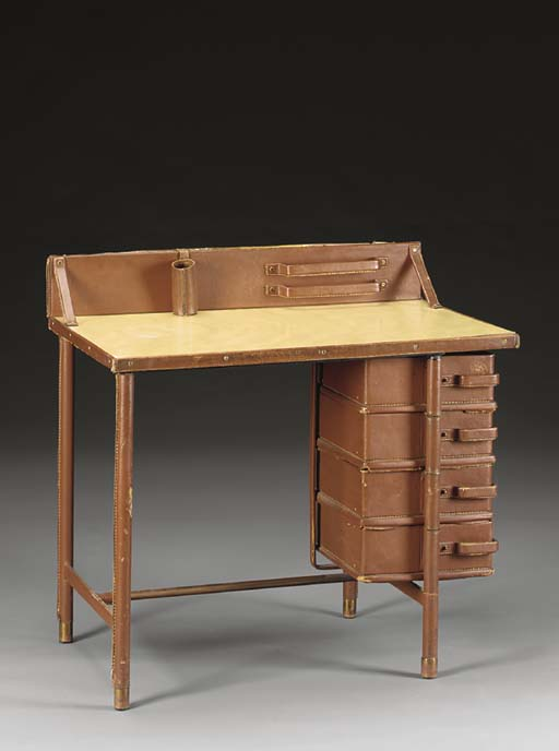 A LEATHER AND BRASS DESK