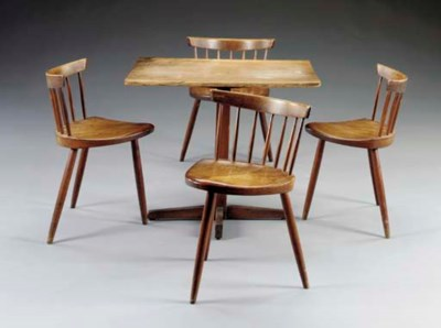 A WALNUT DINING TABLE AND FOUR