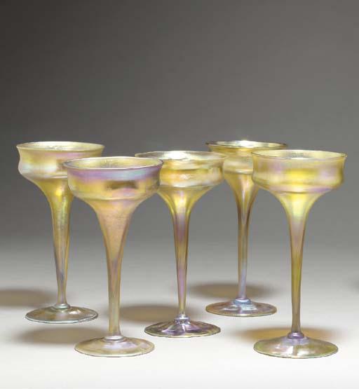 A SET OF FIVE CHAMPAGNE GLASSE