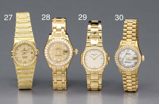 Rolex. A lady's 18K gold and d