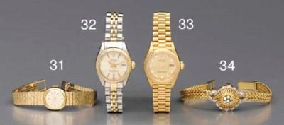 Rolex. A lady's 9K gold cushio
