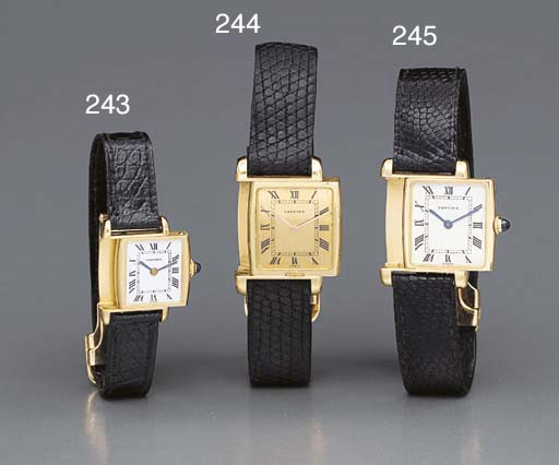 Cartier. A lady's 18K gold rev