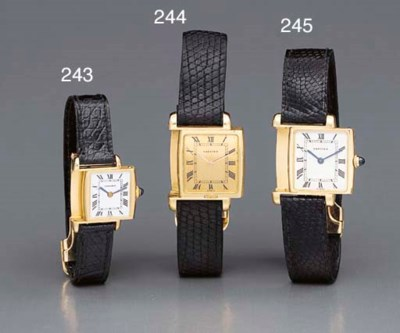 Cartier. A lady's 18K gold rev