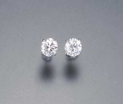 A PAIR OF DIAMOND EAR STUDS AN